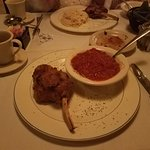 Veal Chop, medium rare with Capella night and Red Sauce.