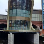 Funky and atmospheric entrance to Leeds Station straddling the water