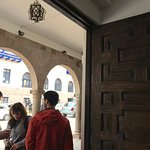 beautiful carved doors open to the lively and safe street