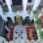 looking down from the terrace into the courtyard of the riad