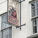 Quaint signage for The Friar's Lodge.