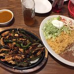 Chicken Fajitas and the massive side plate of rice and beans that comes with it.