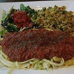 raw zucchini spaghetti and organic tomato sauce