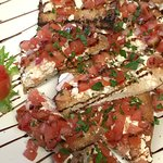 Bruschetta appetizer - goat cheese spread on Perreca's bread crostini & tasty topping