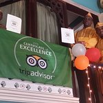 Shehnai staff display the tripadvisor 2016 Certification of Excellence and the Flag.