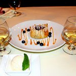 Apple dumpling dessert with vanilla ice cream and Fangelico liqueur.