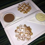 Waffles with salted caramel and white chocolate pistachio rosewater sauces