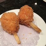 Fried shrimp on sugar cane.