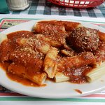 """small"" plate of rigatoni with meatball"