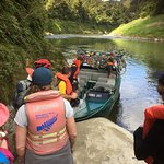 Thomas our guide, taking us down the river, mountain bikes secured on back of jet boat