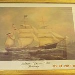 The paintings on the wall provided an atmosphere of old-time maritime activities