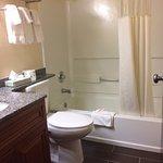 clean bathroom w/ nice vanity and granite coutertop