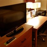 Television and desk area.