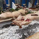 pigs being roasted