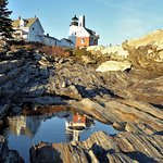 a reflection and the lighthouse