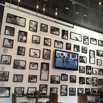 Wall with pictures of Wolfgang Puck