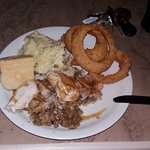Sunday turkey dinner with onion rings side
