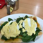 Eggs Benedict with fresh baby spinach on toast