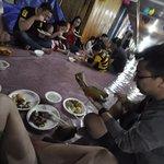 Eating 'Nuba Laya' or Wrap soft rice
