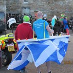 The bikers in the background have a wee cuppa too