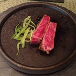 Japanese A4 Wagyu beef sirloin on a hot stone