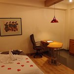 Comfortable writing desk and mini bar (Deluxe Room)