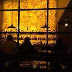 Bar with illuminated stone wall