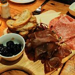 Cheese and meats starter with a very nice grape preserve.