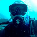 This is me after qualifying as an open water diver. Chuffed, oh about 9 meter down in the Med, C