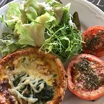 Salmon and spinach quiche with salad