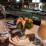 Shrimp cocktail, Corona and Pina Colada