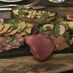 This appetizer with different cheeses bread crackers meat and figs was soooo delicious!!