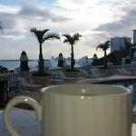 Morning coffee on patio overlooking pool and ocean (Keurig in room, coffee/tea provided)