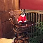 Sugar trying the Victorian Child High Chair at the Gables' Dining room