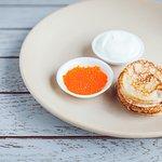 Pancakes with lightly salted local trout caviar | eco-ponds Pērtnieki | and sour cream