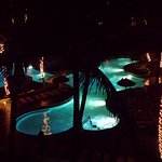 Pools and hotel from our room at night