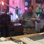 An artisan demonstrates how he shapes neon bulbs