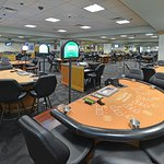 Wide shot of our 50 table poker room in Daytona Beach Florida