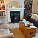 Cosy sitting room with wood fire