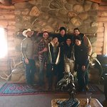 Us and the wonderful staff in front of the fireplace!