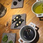 Appitizers: Sponge, cod coated in squid ink and a creamed bean