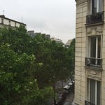 View of classic Paris buildings on Boulevard Voltaire from the corner room.