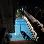 as viewed from our window: the pool and the alley that runs along side the hotel and too Khao Sa