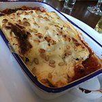 Wiold mushroom cannelloni, tomato ragu, spinach grana padano glaze goats cheese topped with pine
