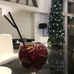 Having a very tasty sangria from the hotel bar in the lobby during the Christmas holiday