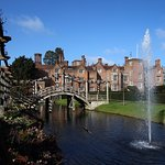 Great Fosters across the Saxon moat and Japanese bridge