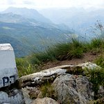 Old Yugoslav border stone, with Albania in the background...