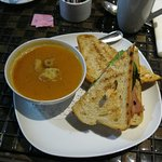 "This is One of the daily specials....carrot soup and a ""ham slam"" sandwich."
