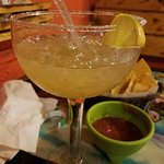 Margarita with chips and salsa in the background