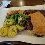 Homemade steak pie with potatoes and veg